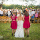 Daughters walking bride down aisle