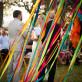Ribbons behind bride and groom at wedding