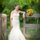 Bride leaning on fence