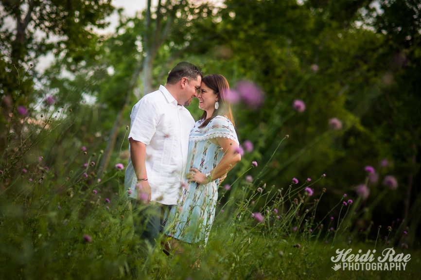 Engagement photos in front of flowers