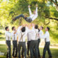 Groomsmen Throwing Groom in the Air