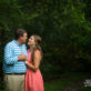 Engagement photo on green backdrop