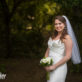 Bride Smiling at Camera outdoors