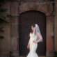 Bride in front of Sea Shell Wall