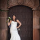 Bride leaning agains doorway