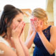 Bride and friend crying