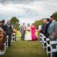 Parents walking Bride down the aisle
