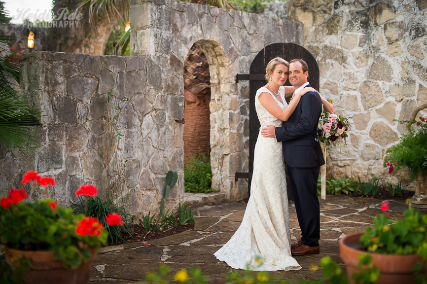 Bride and Groom in front of a stone wall