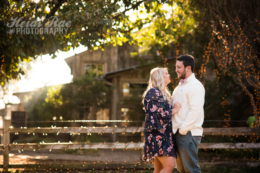 Gruene Texas Engagement Session in front of fence